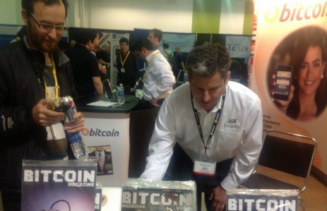 A customer works to transfer bitcoins to BitPay to buy some magazines, while CFO Bryan Krohn (right) processes the transaction. Photo by Carrie Kirby.