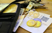 bitcoin-paper-coin-and-usb-wallets