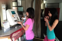 People using bitcoin ATM