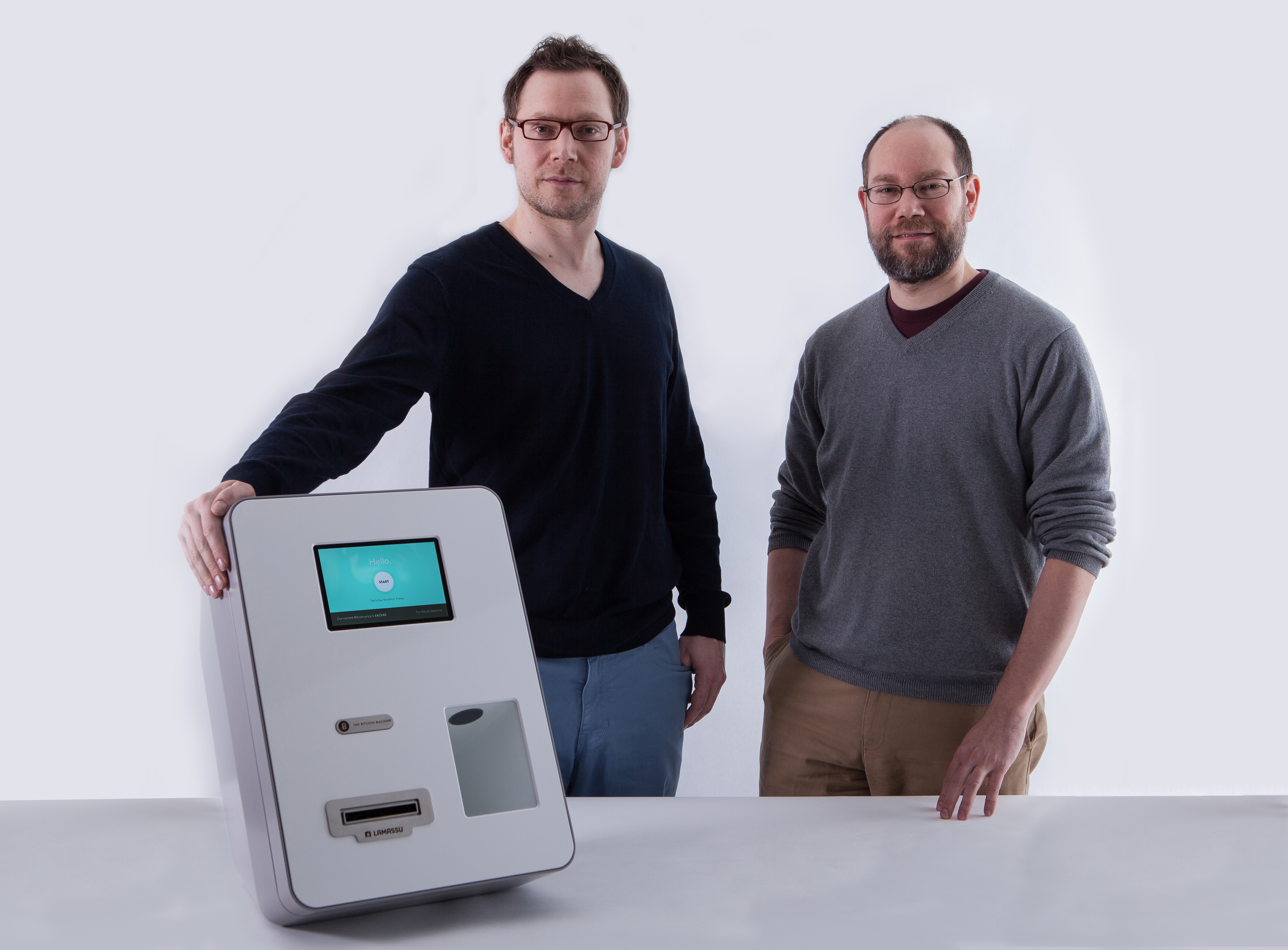 Brothers and co-founders Zach and Josh Harvey with a Lamassu ATM.