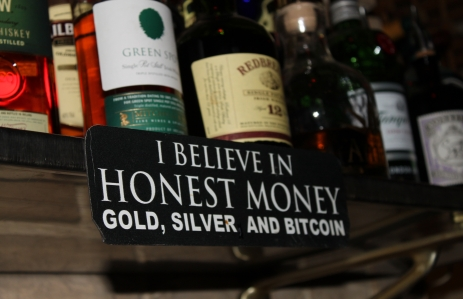 Sign behid the bar in Room 77. Currently celebrating three years of accepting bitcoin