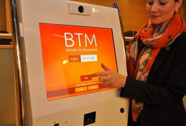Victoria van Eyk demonstrates use of a bitcoin ATM to the Senate