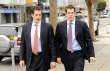 Tyler, right, and Cameron Winklevoss leave a courthouse in San Francisco, California, U.S., on Tuesday, January 11, 2011. The identical twins are contesting a $65 million settlement agreement with Facebook Inc. founder Mark Zuckerberg who they accuse of stealing their idea for the social-networking website. Photographer: Noah Berger/Bloomberg News.