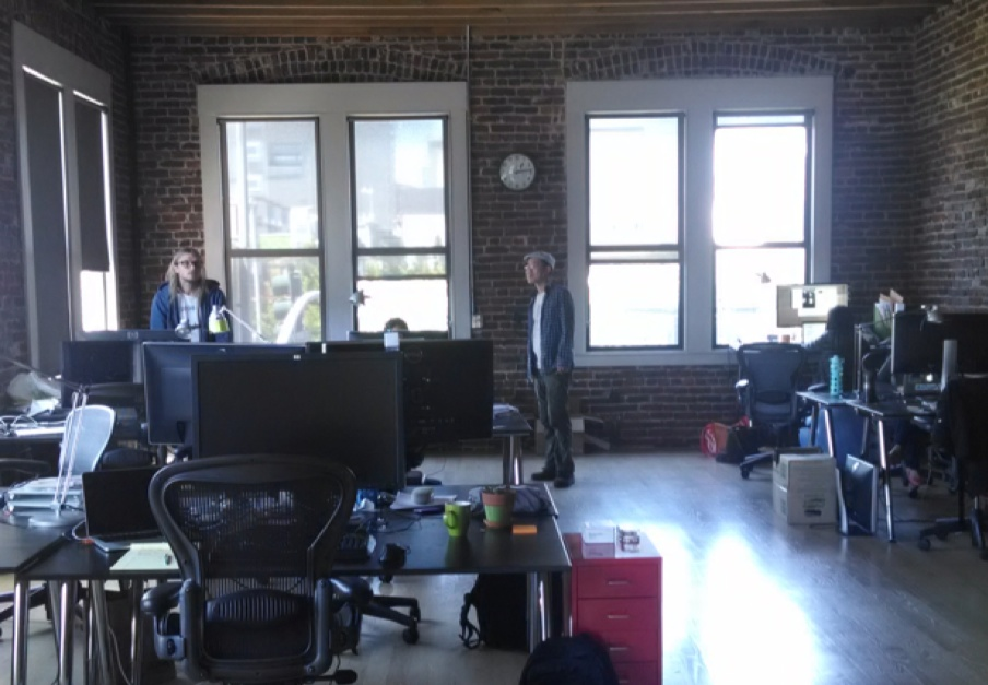 Kraken CEO Jesse Powell and Product Manager Elliot Lee in the company's office.