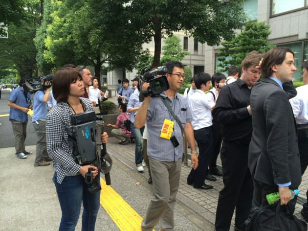 TV crews gather outside the Mt. Gox creditors' meeting