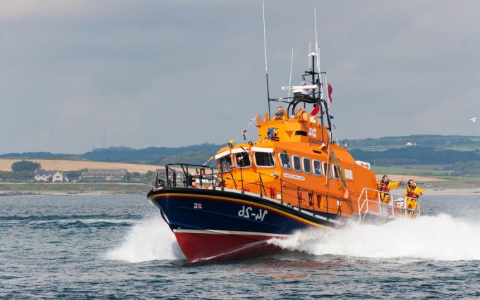 """PORT ST. MARY, ISLE OF MAN, UK - AUGUST 22: Port St. Mary lifeboat """"Gough Ritchie II"""" (Trent class) taking part in RNLI lifeboat festival on August 22, 2012 at Port St. Mary in the Isle of Man, UK.  Copyright: silvergull"""