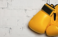 http://www.shutterstock.com/pic-134086694/stock-photo-pair-of-yellow-boxing-gloves-hanging-on-a-brick-wall.html?src=WXQmTNgqdQBzLe1rfL76AQ-1-2