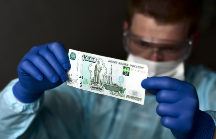http://www.shutterstock.com/pic-116436583/stock-photo-man-specialist-expert-examines-money-bill-russian-rubles.html?src=e1L9E0wTQCwyzE1iPYznag-1-69
