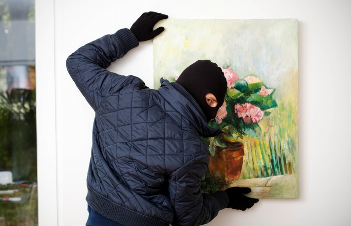 http://www.shutterstock.com/pic-167974337/stock-photo-thief-stealing-the-piece-of-art-from-gallery-of-art.html?src=2qrnbluu4V6EcPjpUVHsYQ-1-93