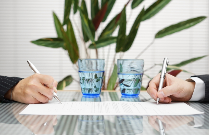 http://www.shutterstock.com/pic-185053982/stock-photo-man-and-woman-signing-document-with-divorce-or-prenuptial-agreement.html?src=chmyzFKQIgE8O9nYq6xM6Q-1-29