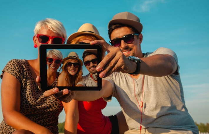http://www.shutterstock.com/pic-214797907/stock-photo-three-young-hipster-friends-taking-selfie-using-digital-tablet.html?src=tVPdR07tukZ64WYf_JThew-1-37