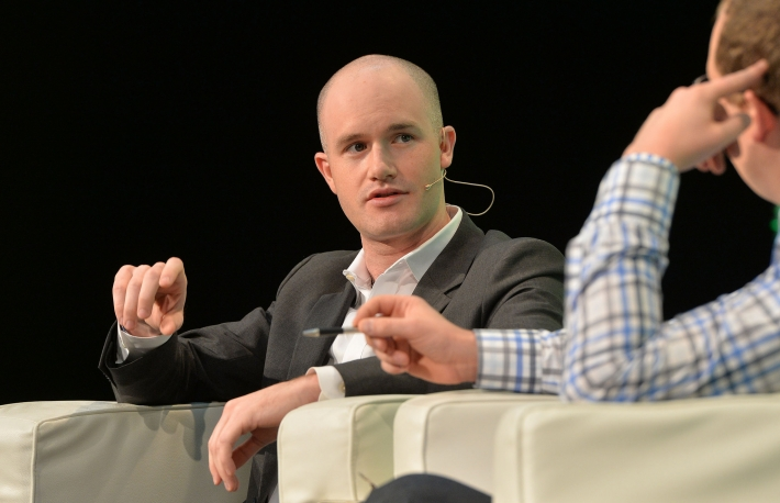 Brian Armstrong onstage at Techcrunch Disrupt London in 2014 interviewed by Alex Wilhelm.