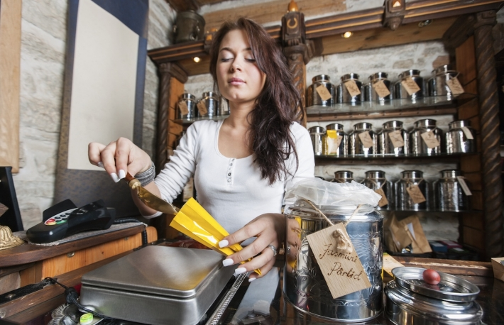 http://www.shutterstock.com/pic-218093950/stock-photo-young-salesperson-scooping-ingredient-into-paper-bag-at-tea-store.html?src=pp-same_model-218094112-tkd1Mxgr7-d8-4PIJUNG9A-7