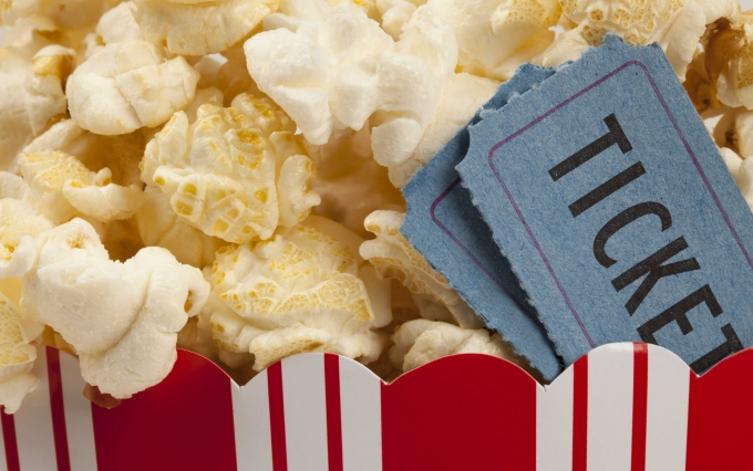 http://www.shutterstock.com/pic-129383348/stock-photo-close-up-of-two-tickets-stubs-in-a-box-of-popcorn-concept-of-movie-time.html?src=wSxF9Y3ld32By3pwcOy9Ew-1-6