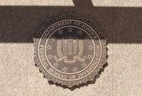 Sign showing FBI emblem at FBI headquarters.