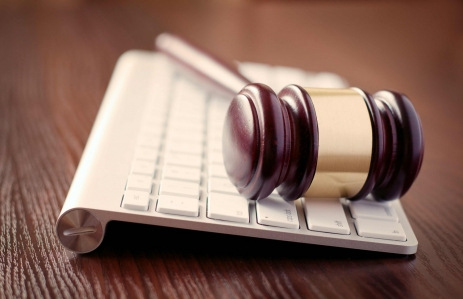 http://www.shutterstock.com/pic-200353580/stock-photo-wooden-judges-gavel-on-a-computer-keyboard-receding-view-with-focus-to-the-head-with-its-brass.html?src=nKYbz6_NslaPT4qGikSeuA-1-60