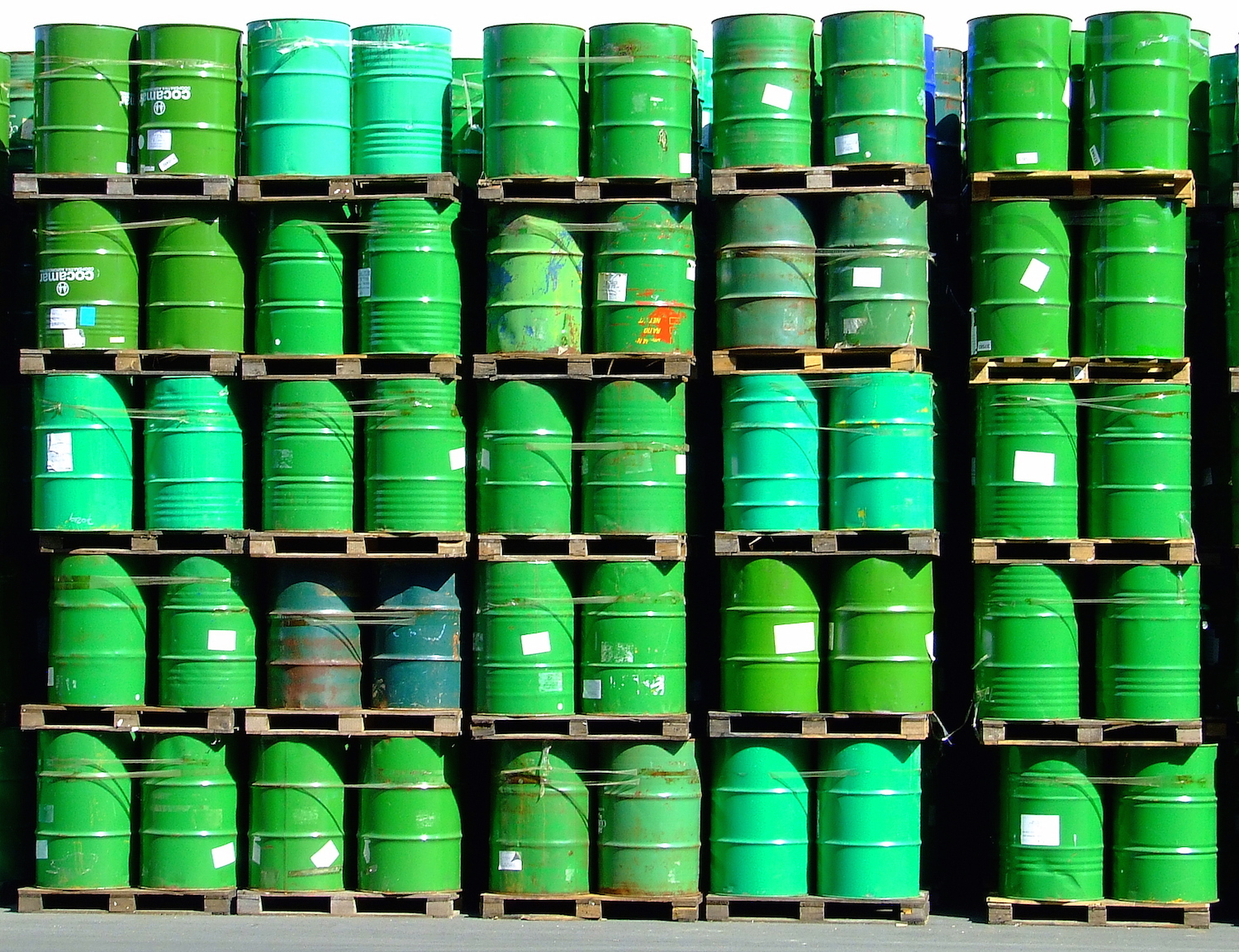 picture of green oil barrels stacked.