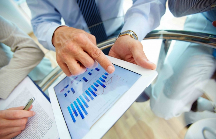 http://www.shutterstock.com/pic-105421997/stock-photo-close-up-of-a-modern-business-team-using-tablet-computer-to-work-with-financial-data.html?src=mmEDXFhQSUpwfwRSrwqOGw-1-2