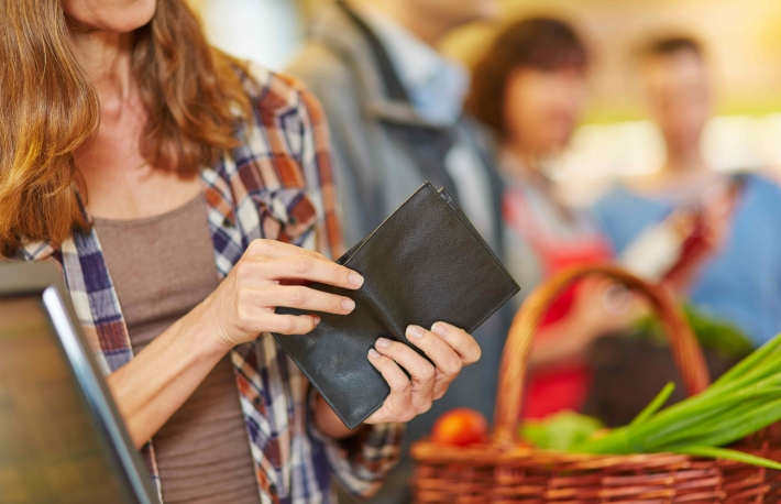 http://www.shutterstock.com/pic-216498037/stock-photo-hand-of-a-woman-looking-for-money-in-wallet-at-supermarket-checkout.html?src=nKOYsZEi4MNINTUrNwdXpQ-1-14