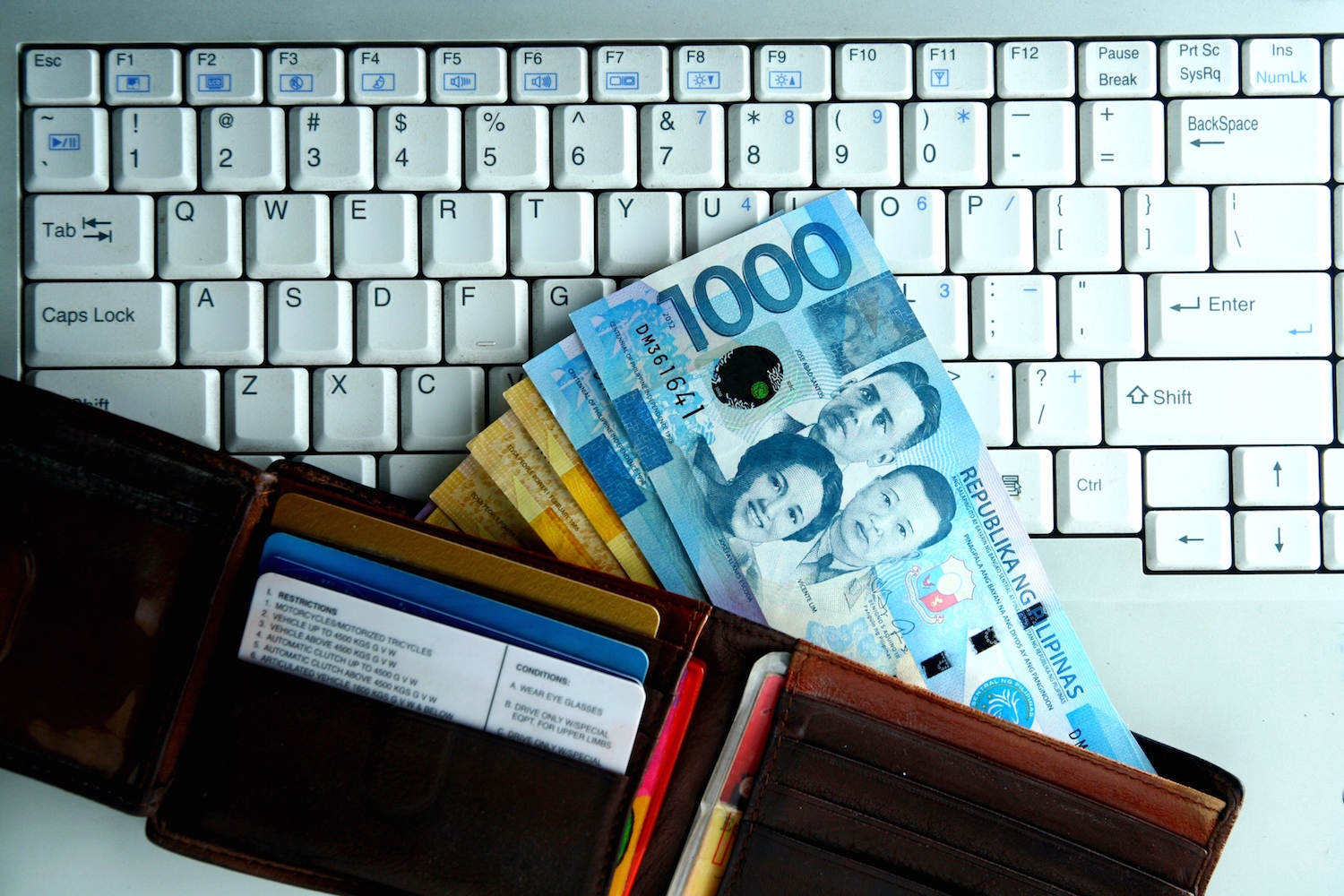 Philippines pesos and keyboard