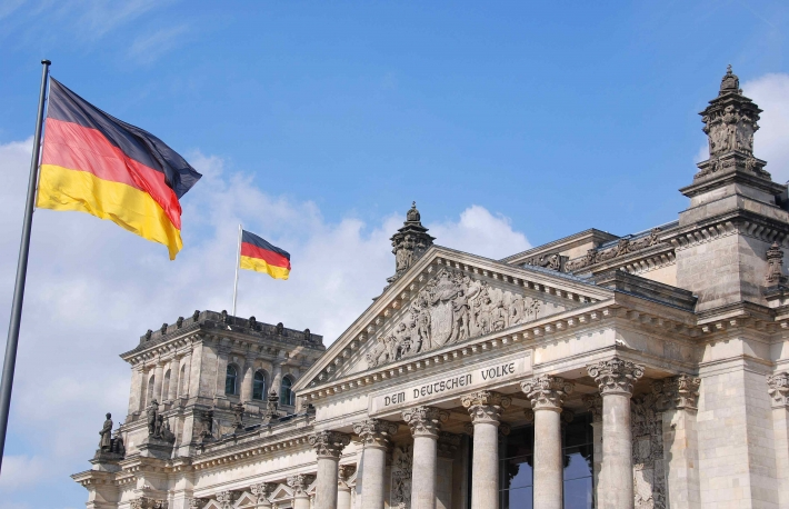 http://www.shutterstock.com/pic-98649335/stock-photo-the-german-flag-streaming-in-front-of-the-german-parliament-building-the-reichstag-at-berlin.html?src=tgR3lvyXLeQPycjsiCKMpg-1-36