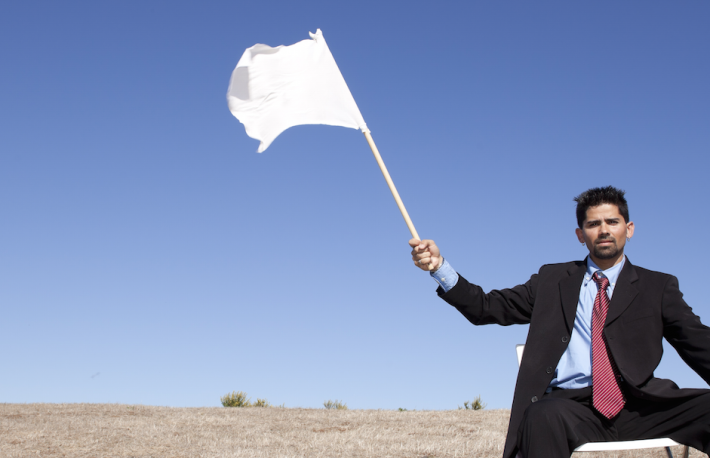http://www.shutterstock.com/pic-92723458/stock-photo-businessman-asking-for-surrendering-holding-a-white-flag.html?src=Gok_1_CGb89gfDLb3ur1gA-1-77