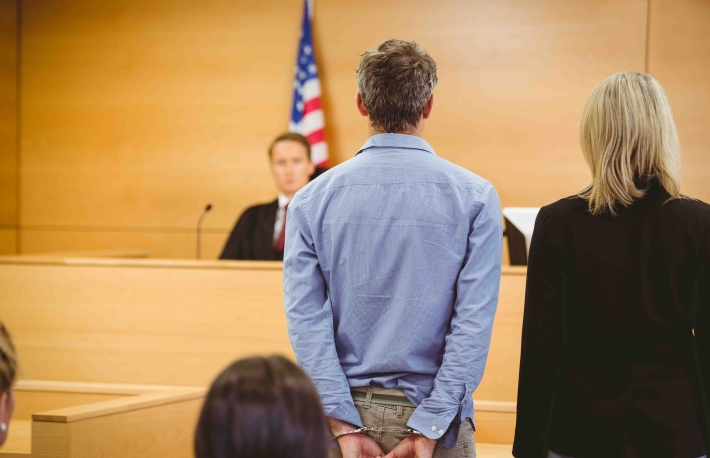 http://www.shutterstock.com/pic-243763714/stock-photo-criminal-waiting-for-courts-ruling-in-the-court-room.html?src=dNw1pQP9a9VDkCwIbTA1DQ-1-70&ws=0