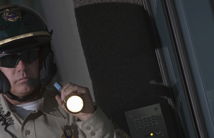 http://www.shutterstock.com/pic-149317463/stock-photo-middle-aged-traffic-cop-investigating-with-flashlight-at-night.html?src=FrHj_5YHRBVHWO4UkXrmhw-1-7&ws=0