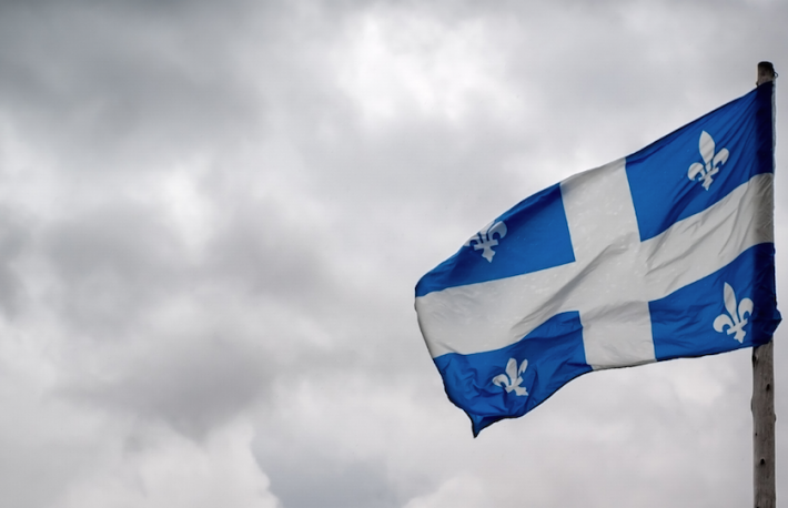 http://www.shutterstock.com/pic-197094032/stock-photo-the-flag-of-quebec-fleurdelise-waves-in-the-wind-in-front-of-the-tumultuous-clouds-of-stormy.html?src=XogWUK_VDAkHzCOGbUlYVQ-2-38&ws=0