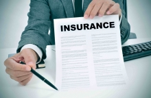 http://www.shutterstock.com/pic-236845816/stock-photo-a-young-man-in-suit-in-his-office-showing-an-insurance-policy-and-pointing-with-a-pen-where-the.html?src=S1xIX2lwaZK2MlndvxFmFA-1-0&ws=0