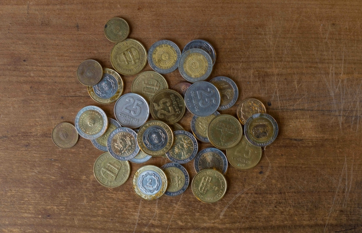 http://www.shutterstock.com/pic-242825422/stock-photo-pile-of-different-value-coins-argentine-currency.html?src=pwSR1sUCD6lZB85bhY3oyw-1-97&ws=0