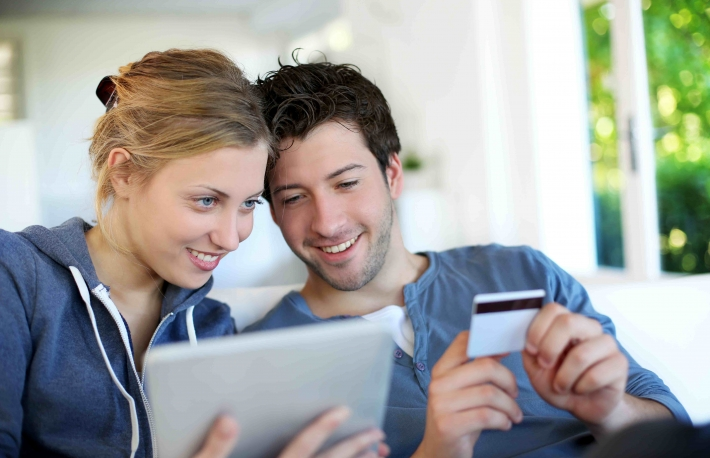 http://www.shutterstock.com/pic-105669257/stock-photo-happy-young-couple-doing-shopping-on-internet.html?src=5KVmyPLs5fFMhhX8FPJS1Q-1-25