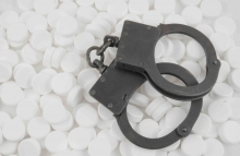 http://www.shutterstock.com/pic-114132079/stock-photo-metallic-handcuffs-on-drugs-background.html?src=dt_last_search-3