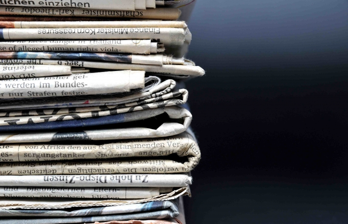 http://www.shutterstock.com/pic-159891725/stock-photo-stack-of-newspapers-on-black-background.html?src=8Q_uXas0VGglzSRvk_2ztg-1-34