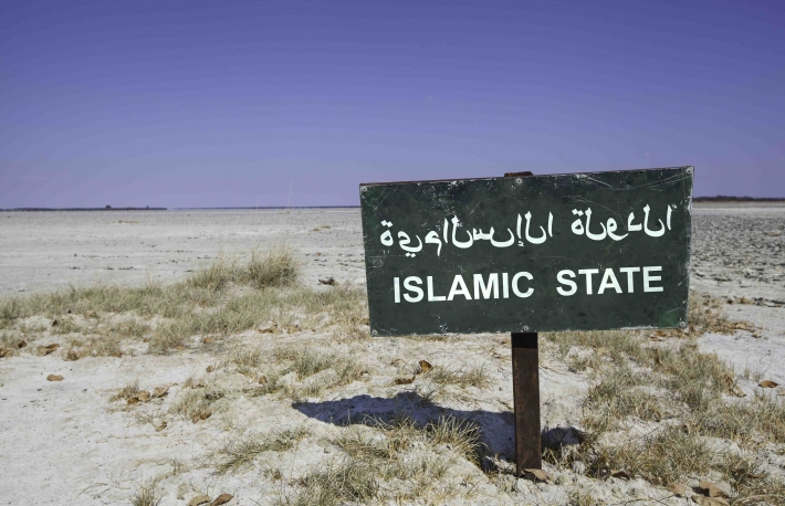 http://www.shutterstock.com/pic-221208910/stock-photo-green-sign-with-the-word-islamic-state-in-arabic-and-english-language-standing-in-the-white-sand-of.html?src=hTsO6HKGkX5M1QXPdeRAJw-1-0&ws=1