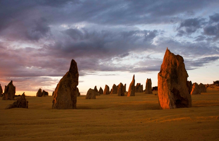 http://www.shutterstock.com/pic-117545158/stock-photo-limestone-formations-glowing-red-at-last-light-in-the-pinnacles-desert-in-nambung-national-park.html?src=Sey8wiK4GvrGZz7aPOQ_RQ-1-1