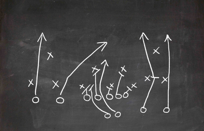 http://www.shutterstock.com/pic-137165630/stock-photo-football-play-strategy-drawn-out-on-a-chalk-board.html?src=DsK2ESkt4Hf2rGuy7hy6ng-1-56