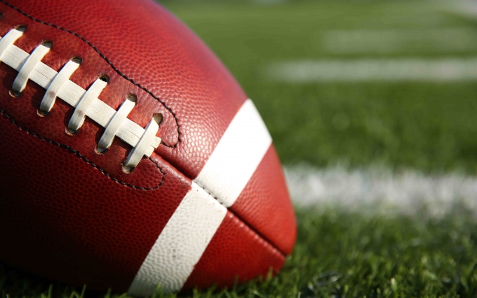 http://www.shutterstock.com/pic-238174666/stock-photo-american-football-on-the-field-with-room-for-copy.html?src=0RNjQ2TV9dseIrdHCihj0Q-1-99