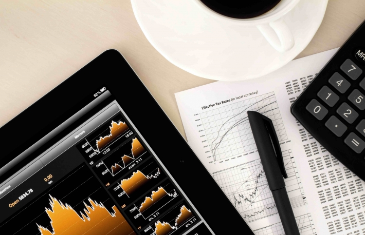 http://www.shutterstock.com/pic-87169798/stock-photo-desktop-in-stock-exchange-office-with-a-tablet-pc-showing-stock-market-chart.html?src=-V4S1BadAJK80LlEbxC6lQ-1-27