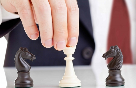 http://www.shutterstock.com/pic-98830343/stock-photo-business-man-holding-chess-queen-figure-between-two-arguing-knight-figures-conflict-management.html?src=rg6BJ6XVV8W8bVLXuF706A-1-44