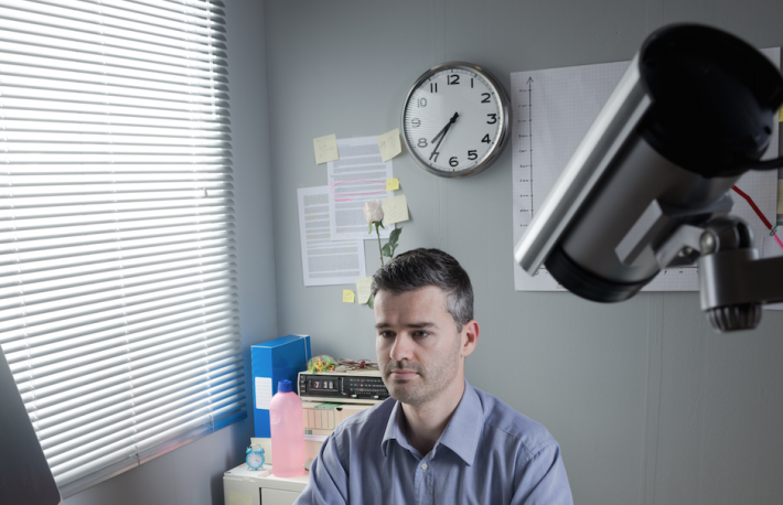 http://www.shutterstock.com/pic-226385698/stock-photo-white-collar-at-office-desk-working-with-surveillance-camera-on-foreground.html?src=czrJK09-AtAjdLqDOKhHdQ-1-46