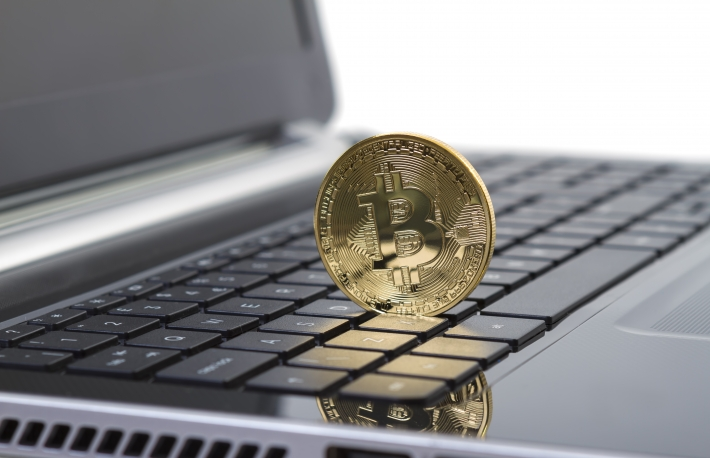 Shutterstock: http://www.shutterstock.com/pic-199192913/stock-photo-galati-romania-june-studio-shot-of-golden-bitcoin-virtual-currency-on-laptop-close-up.html?src=csl_recent_image-1