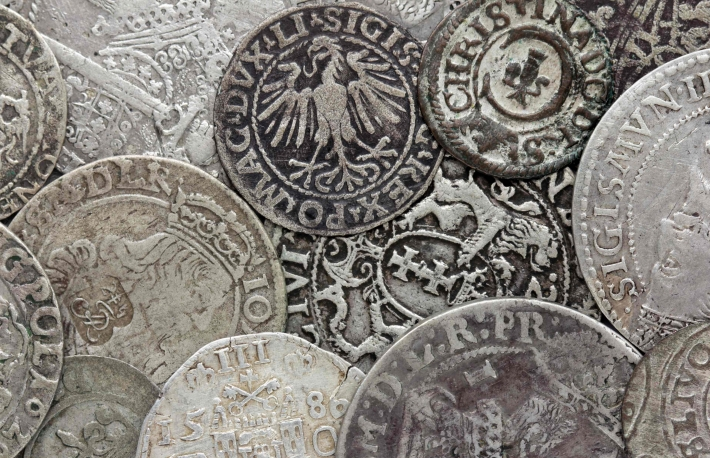 http://www.shutterstock.com/pic-194529686/stock-photo-closeup-view-of-medieval-european-silver-coins-suitable-for-an-abstract-background.html?src=DwSgSZg5uxIdCYvoRTB27Q-1-20