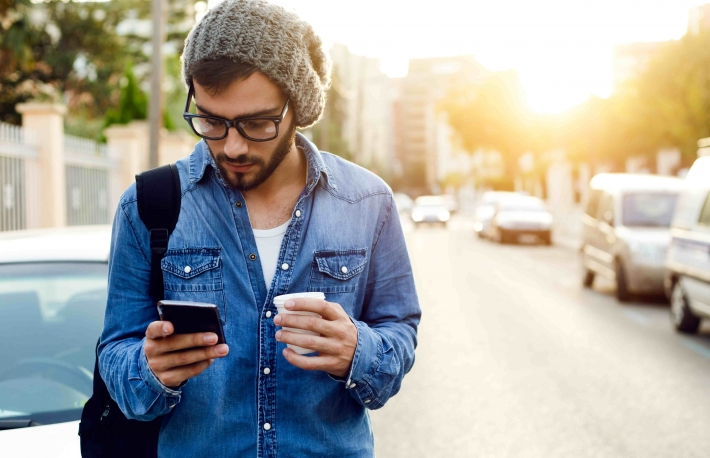 http://www.shutterstock.com/pic-228417220/stock-photo-outdoor-portrait-of-modern-young-man-with-mobile-phone-in-the-street.html?src=Au2TRpvHNyV3-gt2zFSJpw-1-9