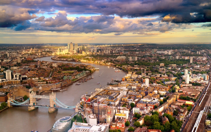 http://www.shutterstock.com/pic-210925708/stock-photo-east-london-skyline-showing-tower-bridge-canary-wharf-city-hall-and-the-thames-river-taken.html?src=DVJpM1kd67JiolVWm404tw-1-12