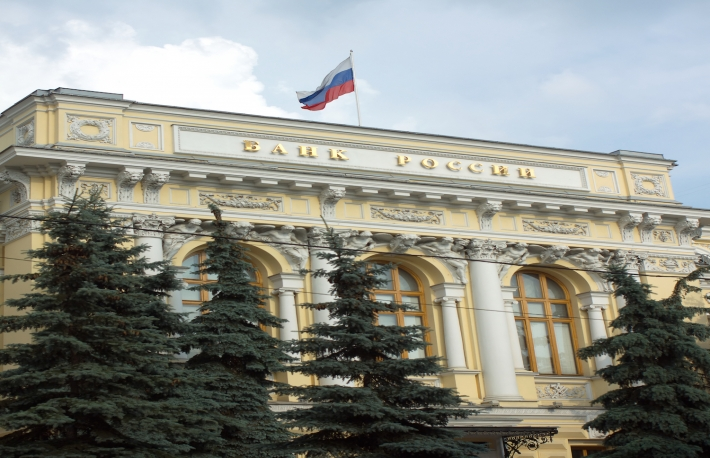 http://www.shutterstock.com/pic-230519020/stock-photo-the-central-bank-of-russia-with-the-inscription-and-russian-flag-on-roof-vertical-photo.html?src=21nuo-gkcl1nXc_Wx12ucw-1-0