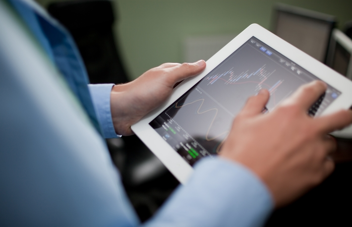http://www.shutterstock.com/pic-111533954/stock-photo-businessman-checking-stock-market-on-tablet.html?src=csl_recent_image-1