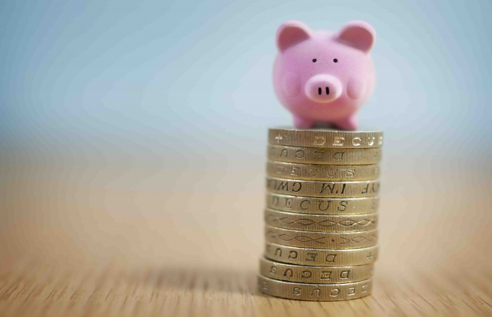 http://www.shutterstock.com/pic-114612430/stock-photo-small-beginnings-micro-piggy-bank-on-top-of-coins-money-concept.html?src=9_5vdMf81frl7CqjlXEe9g-1-61
