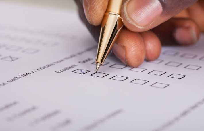 http://www.shutterstock.com/pic-172082504/stock-photo-close-up-of-businessman-filling-customer-survey-form.html