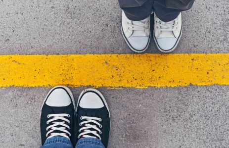 http://www.shutterstock.com/pic-197932532/stock-photo-top-view-of-sneakers-from-above-male-and-female-feet-in-sneakers-standing-at-dividing-frontier.html?src=bjqLX8R4pPdOT7bxtTQYgg-2-33